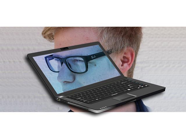 přenosný počítač a hlava